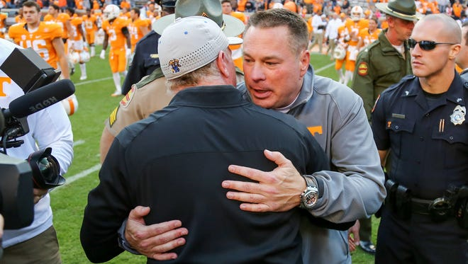 Nov 12, 2016; Knoxville, TN, USA; Tennessee Volunteers head coach Butch Jones and Kentucky Wildcats head coach Mark Stoops meet after the game at Neyland Stadium. Tennessee won 49 to 36. Mandatory Credit: Randy Sartin-USA TODAY Sports