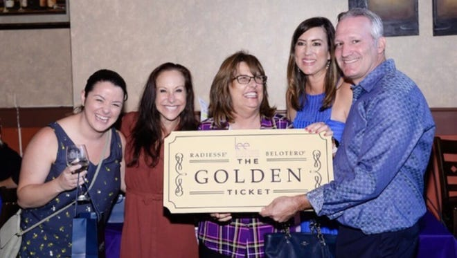 Angela Smith, Alisha Cohen, Golden Ticket winner Georgeann Martin, Michele Pfeiffer and Dr. S. Darrell Lee enjoy the Beauty and Wellness Bash to Benefit HANDS Clinic.