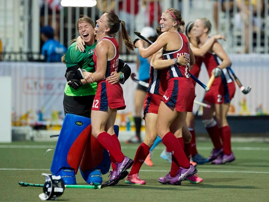 FILE - In this July 24, 2015, file photo, players of the United States team celebrate after winning the gold medal by defeating Argentina during the women's field hockey final at the 2015 Pan Am Games in Toronto. The United States is trying to make a push in women's field hockey. (Darren Calabrese/The Canadian Press via AP, File)