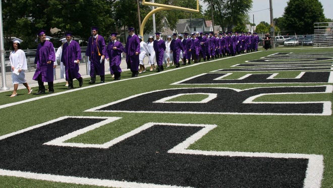 Fremont Ross seniors enter Don Paul Stadium/Harmon Field during the commencement processional. This year Ross High School graduation is set for June 4.