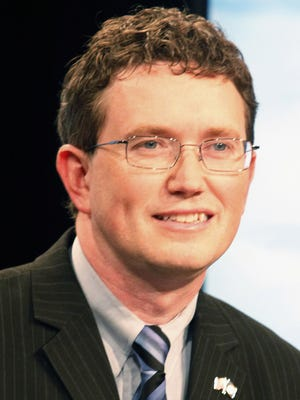 Republican candidate for the 4th Congressional District, Lewis County Judge Executive Thomas Massie prepares for a debate at Kentucky Educational Television studios in Lexington, Ky. on Monday, May 14, 2012. (AP Photo/ James Crisp)
