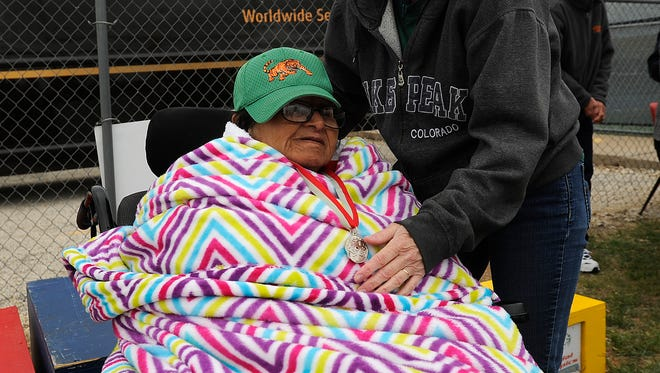 Virginia Scarcella, 76, gets her medal for the softball throw adjusted by Stephanie Storey after her competition in the Special Olympics Area 14 Spring Games on Saturday, April 22, 2017, at Wylie High School's Bulldog Stadium.