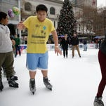 Ian Chan wears shorts and a T-shirt while ice skating Wednesday at Bryant Park in New York.