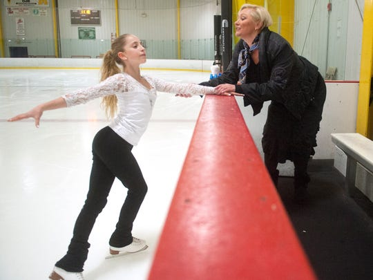 Jenna Gordon, an 11-year-old standout figure skater from Medford, receives instruction from choreography and ballet coach Zhanna Palagina during  practice at the Igloo in Mount Laurel.  02.08.16