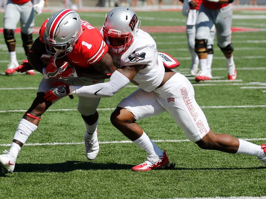 Ohio State receiver Johnnie Dixon, left, crosses the goal line as UNLV defensive back Chauncey Scissum tries to make the tackle during the first half of an NCAA college football game Saturday, Sept. 23, 2017, in Columbus, Ohio. (AP Photo/Jay LaPrete)
