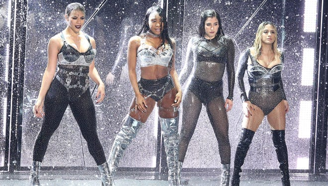 Dinah Jane, from left, Normani Kordei, Lauren Jauregui, and Ally Brooke of Fifth Harmony perform a medley at the MTV Video Music Awards.