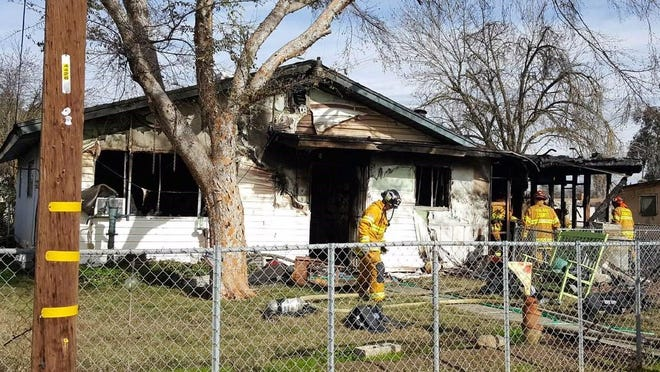 A home in Pixley went up in flames after a wire in a wood burning stove spread into the home.
