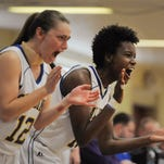 Spalding's Kallie Ash (left) and Kayla Styles (right) cheer for their team as time runs out in an 80-50 win over Eureka College on Saturday during the 2015 SLIAC Championship at Spalding University. Styles was named tournament MVP. (By David Lee Hartlage, Special to the C-J) Feb. 28, 2015.