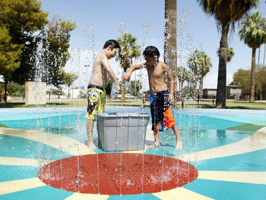 James Rispoli, 9, and Jacob Coaw, 6, play in the splash