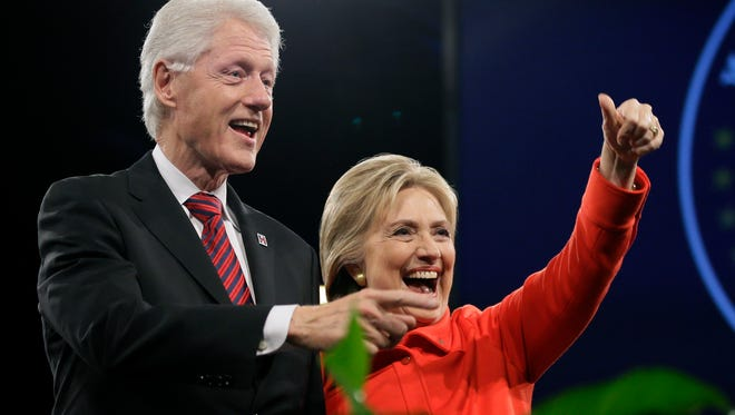 Former President Bill Clinton and his wife, Democratic presidential candidate Hillary Rodham Clinton, wave to supporters after the Iowa Democratic Party's Jefferson-Jackson fundraising dinner in Des Moines, Iowa, on Oct. 24, 2015.