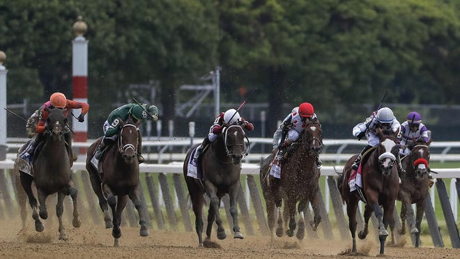 Tiz the Law, second from right, with jockey Manny Franco aboard, leads the pack down the home stretch during the152nd running of the Belmont Stakes on Saturday.