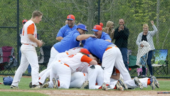 Edison celebrates its 2-1 win over Lansing in the IAC Large School championship game May 16 at Tompkins Cortland Community College.