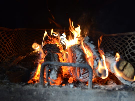 A wood fire crackles under the smoker at Grillin' Dave-Style on Linden Avenue in Zanesville.