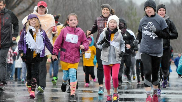 Participants in the Girls on the Run 5K, which was held on Sunday, December 4th, 2016 at the Asheville Outlets. The Girls on the Run is a program that by using a fun, experience-based curriculum which creatively integrates running, inspires girls to be joyful, healthy and confident. MIKE RICE / Citizen-Times