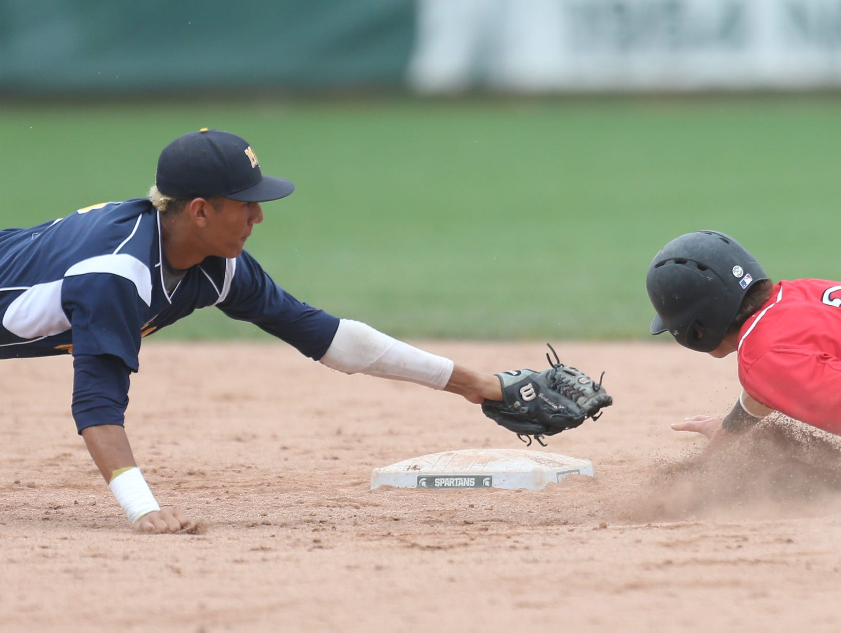 Orchard Lake St. Mary's baserunner Griffin Sheposh steals second against Mt. Pleasant's Obie Ricumstrict in the baseball Div. 2 MHSAA state championship on Saturday, June 13, 2015 at McLane Baseball Stadium in East Lansing.
