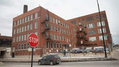 A vehicle drives by a Chicago Police facility on the