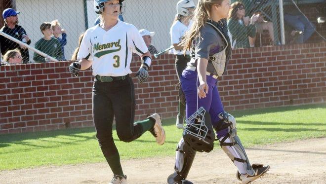 Holy Savior Menard's Abby Gwinn (3, left) scores a run against Rosepine's catcher Lauryn McMahon (3, right) during the regular season. Gwinn and McMahon made the LSCA Class 2A All-State team.