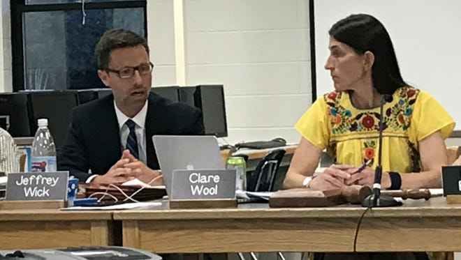 Vice Chairman Jeff Wick and Chairwoman Clare Wool discuss a work halt on June 12, 2018 at a Hunt Middle School meeting of the Burlington School Board.