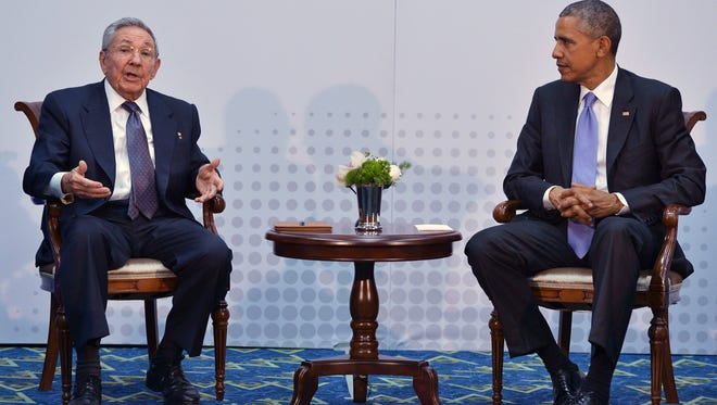 Cuba President Raul Castro speaks with President Barack Obama on the sidelines of the Summit of the Americas at the ATLAPA Convention center on April 11, 2015 in Panama City.