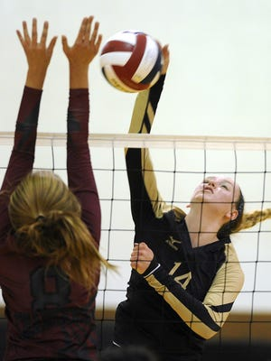 Abilene High's Hannah Tawney (14) spikes the ball past Keller Central's Savanna Sherman (8) during the first game of the Lady Eagles' loss on Tuesday, Sept. 13, 2016, at Abilene High School.