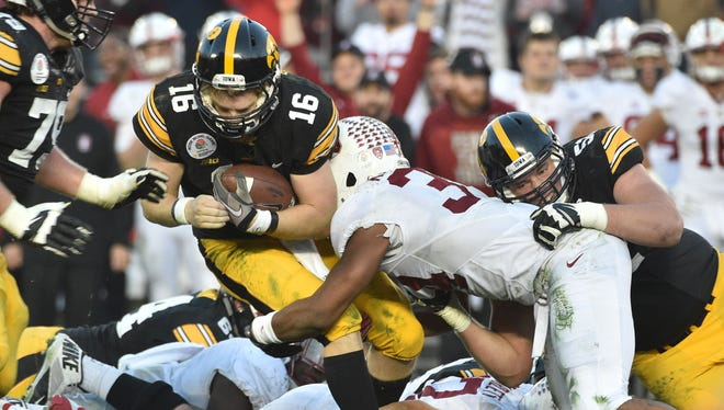 The Iowa offensive line, considered to be one of the best in the nation, struggled on Friday, allowing seven sacks in the Rose Bowl.