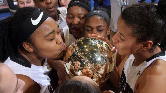 Ossining players take turns kissing the gold ball after defeating Alberts Magnus 80-77 to win the Section 1 Class AA championship at the Westchester County Center in White Plains March 5, 2017.