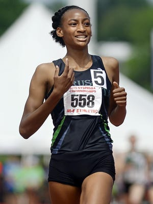 Rush-Henrietta's Sammy Watson smiles as she crosses the finish line after winning 1,500-meters at the NYSPHSAA Track & Field Championships at SUNY Albany on June 13, 2015.