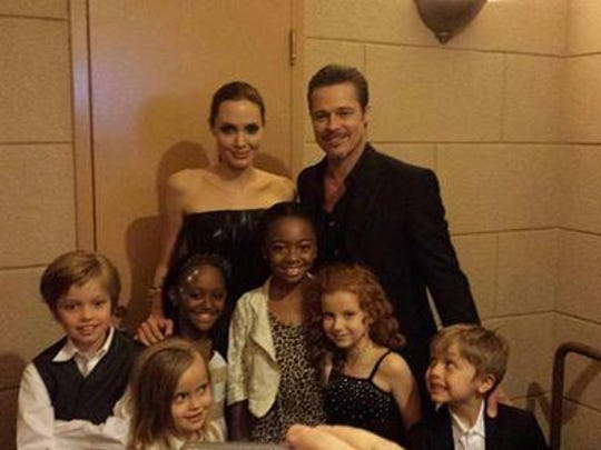 "Angelina Jolie, Brad Pitt and their children Zahara, 9, Shiloh, 8, Vivenne, 5, and her twin brother Knox, and another friend, pose with actress Francesca Capaldi at the premiere of Jolie's 2014 movie ""Maleficent,"" the big-budget Disney live-action tale. The Jolie-Pitt children are fans of Capaldi's Disney Channel TV show, ""Dog with a Blog."" Courtesy of Anthony Capaldi"