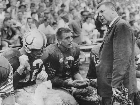 Baltimore Colts coach Weeb Ewbank, right, talks with quarterback Johhny Unitas, center, and end Ray Berry. Unitas tossed a 10-yard pass to Berry during an exhibition game against the Chicago Cardinals at the fairgrounds stadium in Louisville.  By Gean Baron, The Courier-Journal. Sept. 15, 1957