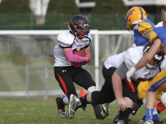 Palmyra running back Carl Reigle makes a move against