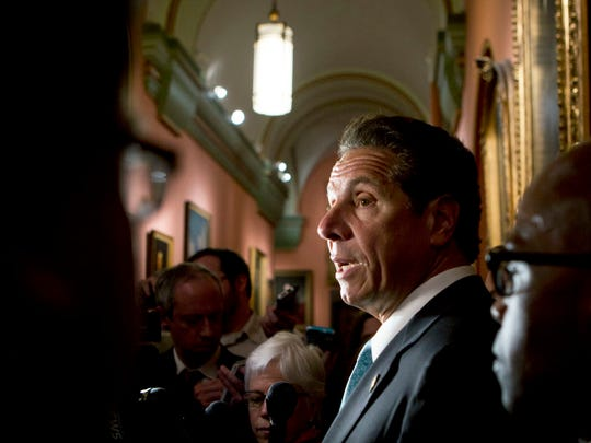 New York Gov. Andrew Cuomo talks to reporters outside