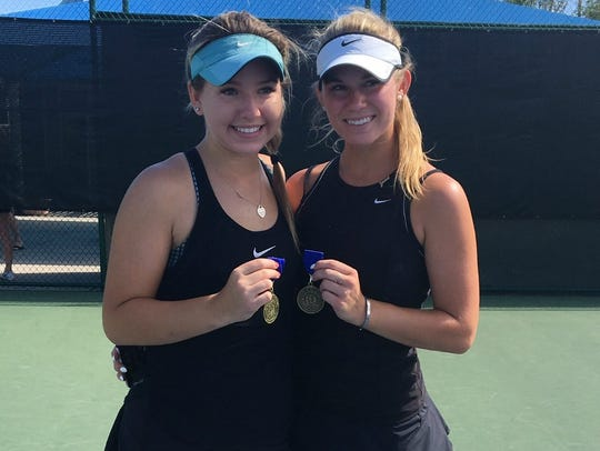 Grace Koester and her doubles partner Erin Hannen celebrate