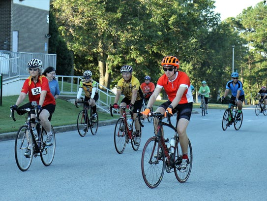 Cyclists make their way to the starting line Saturday