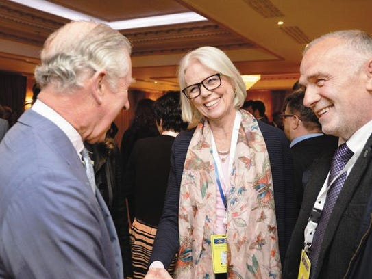 Author Penny Junor with Prince Charles, left.