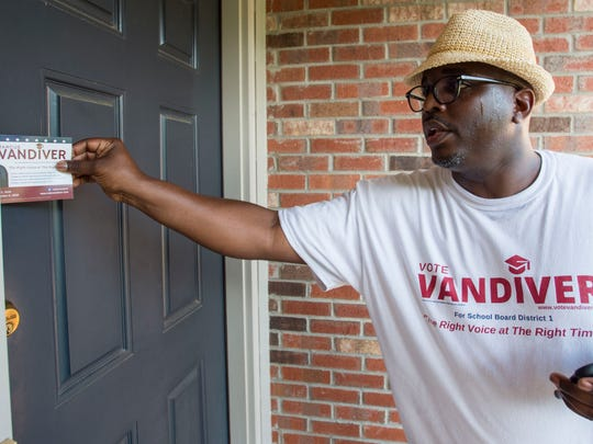 Marcus Vandiver, Democratic candidate for Montgomery School Board of Education District 1, campaigns to win the runoff, June 19, 2018, in the Stoney Brook neighborhood in Montgomery, Ala.