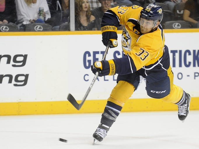 Nashville Predators center Colin Wilson fires a shot against the Tampa Bay Lightning during the third period at Bridgestone Arena on Sept. 24, 2013.