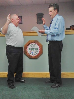 Ronald Luttrell II, left, was being sworn in as Madison Township Fire Chief by trustee Dan Fletcher on May 1, 2017.