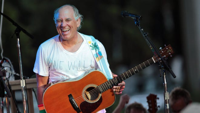 Jimmy Buffett performs at his sister's restaurant in Gulf Shores, Alabama Wednesday, June 30 2010.