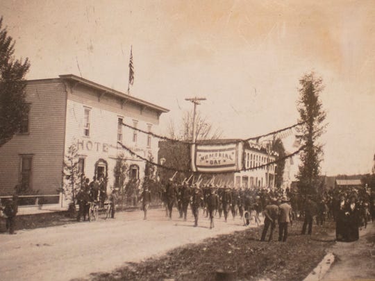 While the people and clothing styles may have changed since the pictured 1901 Memorial Day parade on Main Street in downtown Mishicot, several of the buildings in the background are still recognizable. On the left was the Central Hotel, once home to the switchboard for the Mishicot Telephone Company. Today, the building houses R.E.B.'s tavern. Farther down the street is Terens Hardware store, now home to Main Street Coffee Haus and Bistro, and the Badger State House, now Cozy Corner Café.