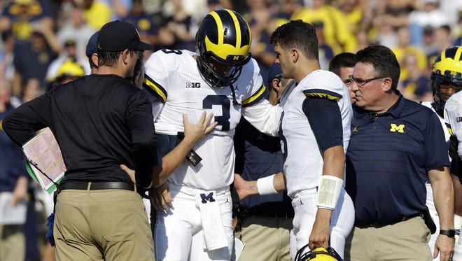 Michigan quarterback Wilton Speight leaves the field after being injured at Purdue on Sept. 23.