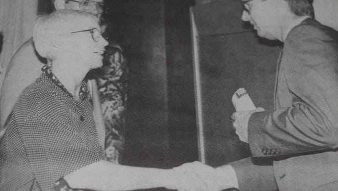 Danille and Tom Duncan talked with Larry Brown, Kentucky Cabinet for Economic Development director after the Morganfield Chamber of Commerce banquet in July 1993.