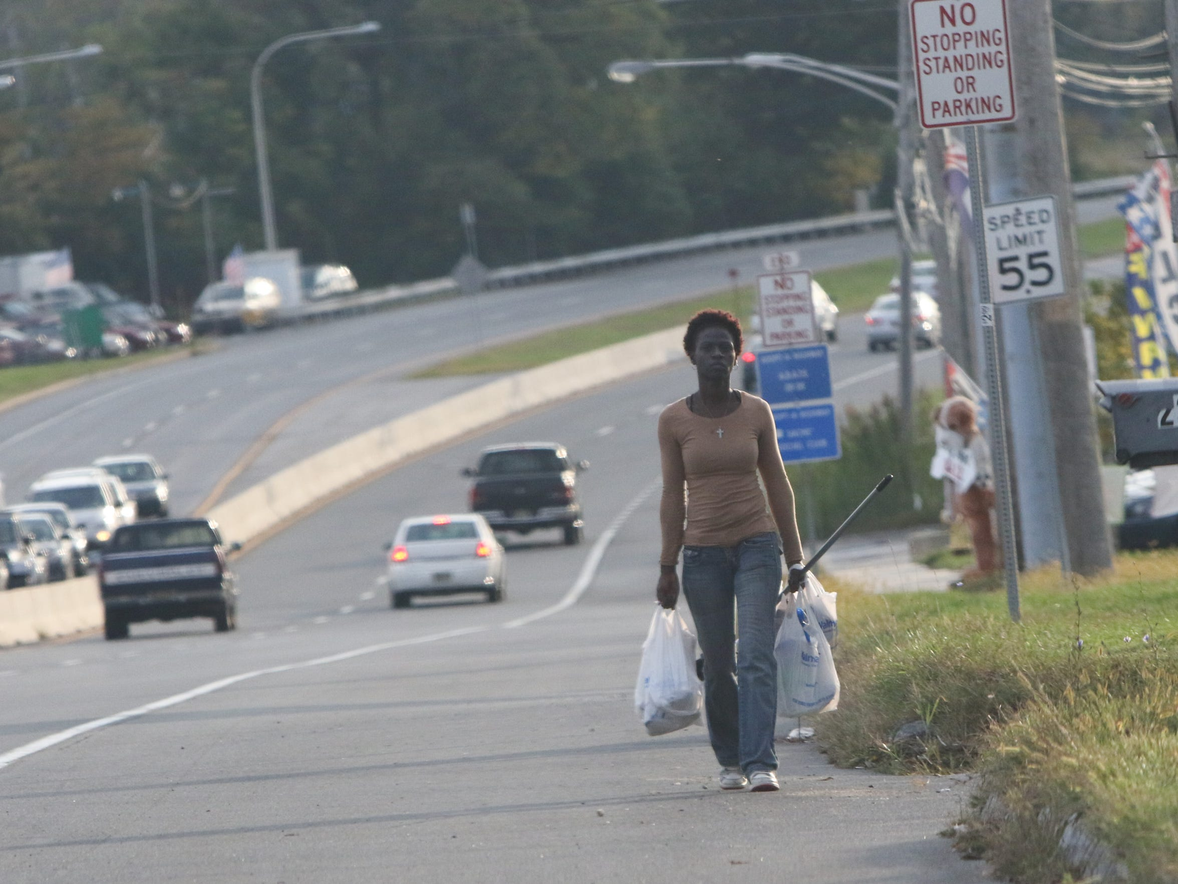 Shayne Jackson walks along U.S. 13, from Wal-Mart to