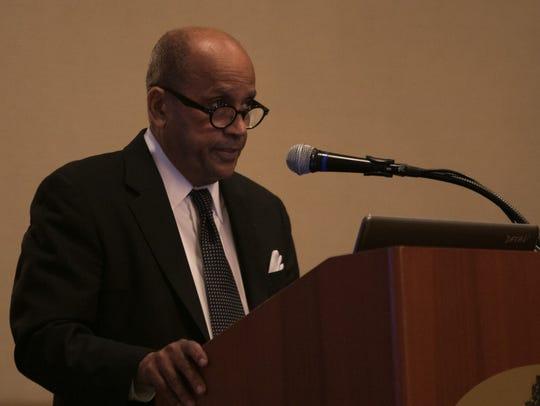 University of Delaware professor Leland Ware speaks