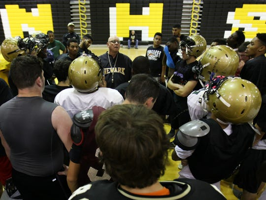 Newark football coach Butch Simpson holds practice in the gym Tuesday. Friday, Simpson will coach his final game, after a 39 year career.