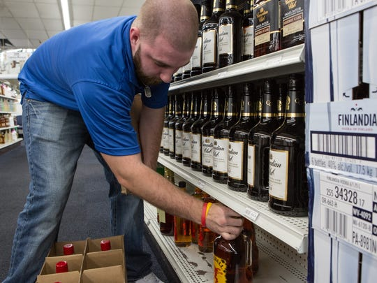 Michael Cooper, of Salisbury, restocks bottles of liquor at the Wicomico County Liquor Dispensary on South Salisbury Boulevard on Tuesday, March 29, 2016.