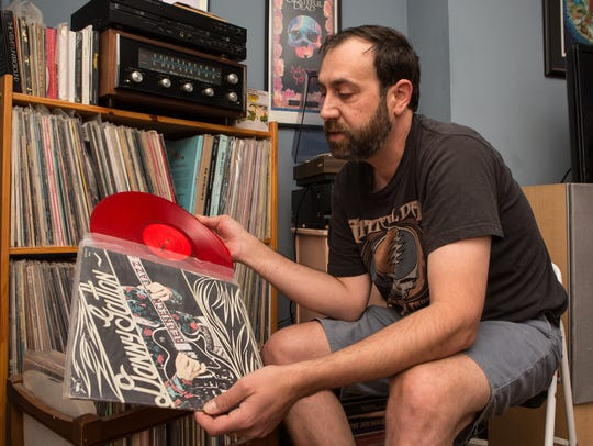 Record collector Mathew Gunby, of Salisbury, holds