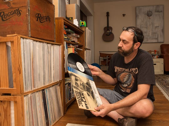 "Record collector Mathew Gunby, of Salisbury, holds a white label edition of Bob Dylan's ""The Times They Are A-Changin'"" on Friday, May 27, 2016."