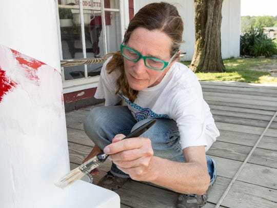 Frontier Town sub-contractor, Sally Crawford, paints