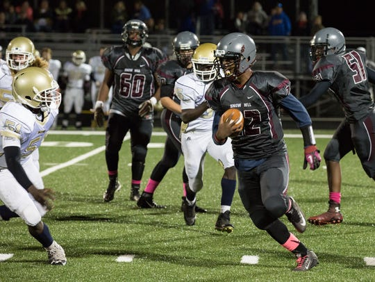 Snow Hill's A-Monty Allen (22) rushes during a game