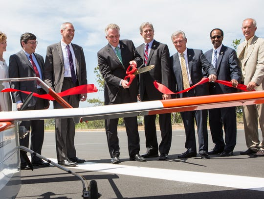 Virginia Governor Terry McAuliffe cuts a ribbon on